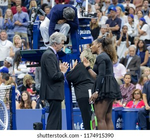 New York, NY - Sep 8, 2018: Serena Williams discusses with umpire, tournament referee & grand slam supervisor code violation she received during women's final of US Open against Naomi Osaka of Japan