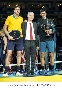 New York, NY - Sep 9, 2018: Trophy presentation for men's single final of US Open 2018 with Novak Djokovic of Serbia & Juan Martin del Potro of Argentina, John McEnroe at USTA National Tennis Center