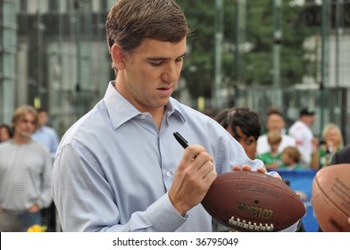 NEW YORK, NY - SEPT 8: Eli Manning, Quarterback of the New York Giants signs autographs while visiting CBS Early Show on Sept 8, 2009