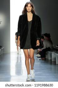 NEW YORK, NY - September 06, 2018: Camille Hurel walks the runway during rehearsal for the Jeremy Scott Spring Summer 2019 fashion show during New York Fashion Week