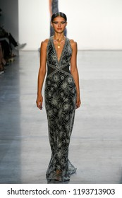 NEW YORK, NY - SEPTEMBER 06: A model walks the runway for Tadashi Shoji during New York Fashion Week: The Shows at Gallery II at Spring Studios on September 6, 2018 in New York City.