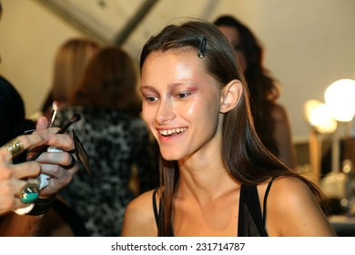 NEW YORK, NY - SEPTEMBER 06: A model has her make-up done backstage at Venexiana during Mercedes-Benz Fashion Week Spring 2015 at Lincoln Center on September 6, 2014 in NYC