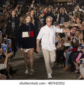 NEW YORK, NY - SEPTEMBER 09, 2016: Gigi Hadid and designer Tommy Hilfiger walk the runway at Tommy Hilfiger Women's Fashion Show during New York Fashion Week at Pier 19