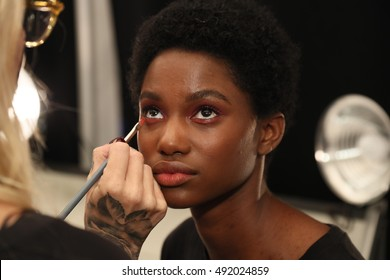 NEW YORK, NY - SEPTEMBER 09: A model getting ready backstage before the Tadashi Shoji Spring 2017 Runway Show  on September 9, 2016 in New York City.