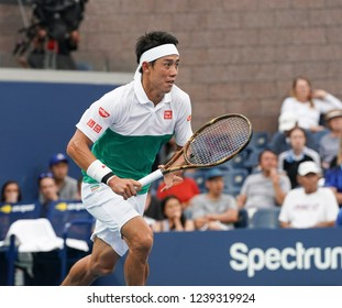 New York, NY - September 1, 2018: Kei Nishikori of Japan chases ball during US Open 2018 3rd round match against Diego Schwartzman of Argentina at USTA Billie Jean King National Tennis Center