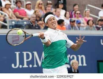 New York, NY - September 1, 2018: Kei Nishikori of Japan returns ball during US Open 2018 3rd round match against Diego Schwartzman of Argentina at USTA Billie Jean King National Tennis Center