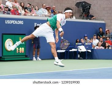 New York, NY - September 1, 2018: Kei Nishikori of Japan serves during US Open 2018 3rd round match against Diego Schwartzman of Argentina at USTA Billie Jean King National Tennis Center