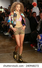 NEW YORK, NY - SEPTEMBER 10: A model walks the runway at the Jeremy Scott fashion show during MADE Fashion Week Spring 2015 at Milk Studios on September 10, 2014 in NYC.