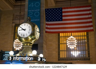 NEW YORK, NY - SEPTEMBER 11: MTA information booth iconic clock in Grand Central Terminal with large flag in background New York City, New York on September 11, 2018.