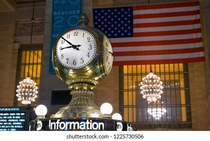 NEW YORK, NY - SEPTEMBER 11: Iconic clock in Grand Central Terminal with American Flag in background of New York City, New York on September 11, 2018.
