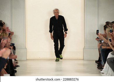 NEW YORK, NY - SEPTEMBER 11: Designer Ralph Lauren greets the audience during Mercedes-Benz Fashion Week Spring 2015 at Skylight Clarkson Sq on September 11, 2014 in New York City.