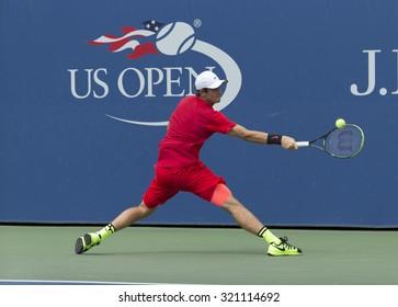 New York, NY - September 11, 2015: Tommy PAul of USA returns ball during quarterfinal against Seong-chan Hong of Korea at junior boys US Open