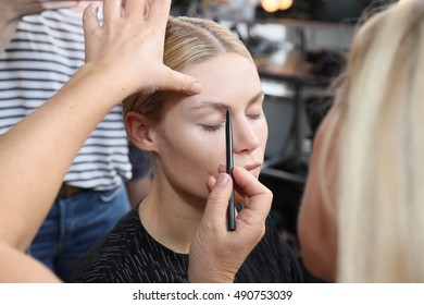 NEW YORK, NY - SEPTEMBER 11: A model getting ready backstage before the Custo Barcelona fashion show during New York Fashion Week September 2016 on September 11, 2016 in New York City.