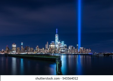 NEW YORK, NY - SEPTEMBER 11, 2016: View of Lower Manhattan, New York City at night from Jersey City, New Jersey on September 11, 2016. Tribute in light - 15th anniversary of the 9/11 attacks.