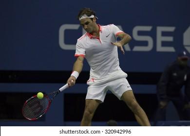 New York, NY - September 13, 2015: Roger Federer of Switzerland returns ball against Novak Djokovic of Serbia during final of US Open Championship at Ash stadium