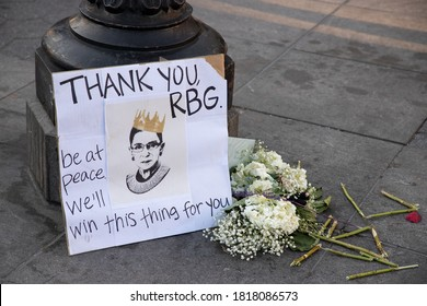 NEW YORK, N.Y. – September 19, 2020: A makeshift memorial to United States Supreme Court Justice Ruth Bader Ginsburg is seen in Washington Square Park.