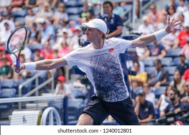 New York, NY - September 2, 2018: Kevin Anderson of South Africa returns ball during US Open 2018 4th round match against Dominic Thiem of Austria at USTA Billie Jean King National Tennis Center