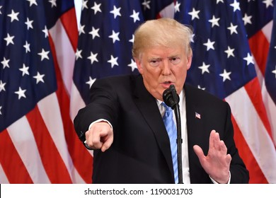 NEW YORK, NY - SEPTEMBER 26, 2018: President Donald Trump points to a reporter he selected to answer a question at a news conference held at the Villard Room of the Lotte Palace Hotel.
