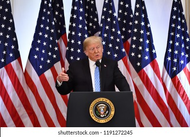 NEW YORK, NY - SEPTEMBER 26, 2018: President Trump addresses the press as reporters ask him questions at a news conference at the Lotte Palace Hotel in the Villard Room.