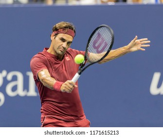 New York, NY - September 3, 2018: Roger Federer of Switzerland returns ball during US Open 2018 4th round match against John Millman of Australia at USTA Billie Jean King National Tennis Center
