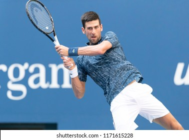 New York, NY - September 3, 2018: Novak Djokovic of Serbia returns ball during US Open 2018 4th round match against Joao Sousa of Portugal at USTA Billie Jean King National Tennis Center