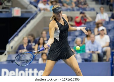 New York, NY - September 3, 2018: Maria Sharapova returns ball during US Open 2018 4th round match against Carla Suarez Navarro of Spain at USTA Billie Jean King National Tennis Center