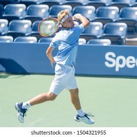 New York, NY - September 3, 2019: Toby Alex Codat (USA) in action during 1st round of US Open Championship boys juniors against Olimjon Nabiev (Uzbekistan) at Billie Jean King National Tennis Center