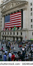 NEW YORK, NY -- SEPTEMBER 30, 2008: Media and Spectators gather outside the New York Stock Exchange on September 30, 2008, the day after the record-breaking 777-point drop in the Dow