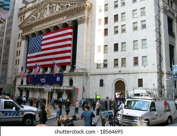 NEW YORK, NY -- SEPTEMBER 30, 2008: The NYPD and News Crews Stand Watch Outside the New York Stock Exchange on September 30, 2008, the day after the record-breaking 777-point drop in the Dow
