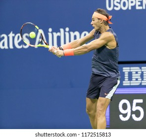 New York, NY - September 4, 2018: Rafael Nadal of Spain returns ball during US Open 2018 quarterfinal match against Dominic Thiem of Austria at USTA Billie Jean King National Tennis Center