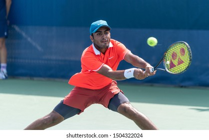 New York, NY - September 4, 2019: Govind Nanda (USA) in action during 2nd round of US Open Championship boys juniors against Peter Makk (Hungary) at Billie Jean King National Tennis Center