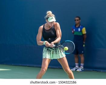 New York, NY - September 4 2019: Alexandra Yepifanova (USA) in action during 2nd round of US Open Championship boys juniors against Linda Fruhvirtova (Czech Republic) at Billie Jean King Tennis Center