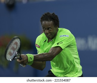 NEW YORK, NY - SEPTEMBER 4, 2014: Gael Monfils of France returns ball during quarterfinal match against Roger Federer of Switzerland at US Open championship in Flushing Meadows USTA Tennis Center
