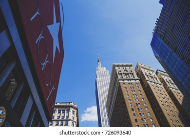 NEW YORK, NY - September 4th, 2017: The Empire State Building and Macy's iconic shopping bag on its building