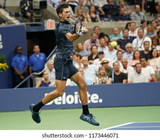 New York, NY - September 5, 2018: Novak Djokovic of Serbia returns ball during US Open 2018 quarterfinal match against John Millman of Australia at USTA Billie Jean King National Tennis Center