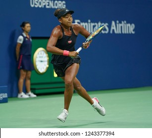 New York, NY - September 6, 2018: Naomi Osaka of Japan returns ball during US Open 2018 semifinal match against Madison Keys of USA at USTA Billie Jean King National Tennis Center