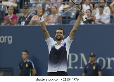 NEW YORK, NY - SEPTEMBER 6, 2014: Marin Cilic of Serbia celebrates victory of semifinal match against ROger Federer of Switzerland at US Open championship in Flushing Meadows USTA Tennis Center