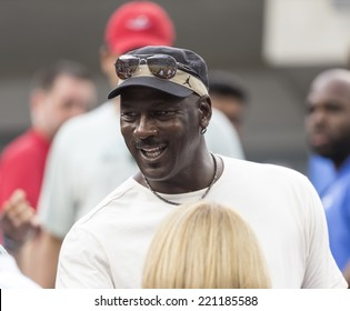 NEW YORK, NY - SEPTEMBER 6, 2014: Michael Jordan attends semifinal match Marin Cilic of Croatia & Roger Federer of Switzerland at US Open championship in Flushing Meadows USTA Tennis Center
