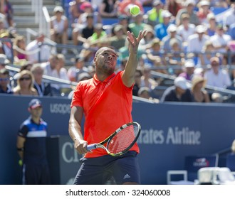 New York, NY - September 6, 2015: Jo-Wilfried Tsonga of France serves during 4th round match against Benoit Paire of France at US Open Championship