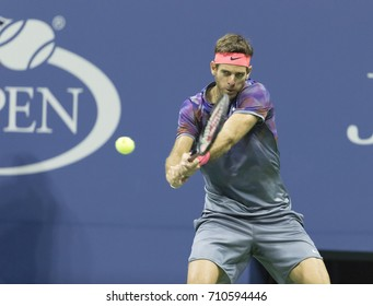 New York, NY - September 6, 2017: Juan Martin del Potro of Argentina returns ball during match against Roger Federer of Switzerland at US Open Championships at Billie Jean King National Tennis Center