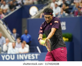 New York, NY - September 7, 2018: Kei Nishikori of Japan returns ball during US Open 2018 semifinal match against Novak Djokovic of Serbia at USTA Billie Jean King National Tennis Center