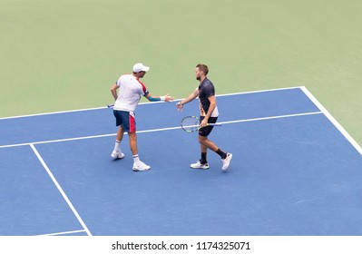 New York, NY - September 7, 2018: Jack Sock and Mike Bryan in action against Lukasz Kubot and Marcelo Melo in the men's doubles final at USTA Billie Jean King National Tennis Center