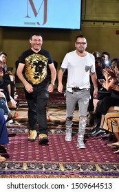 New York, NY - SEPTEMBER 7, 2019: Designers Mario and Jorge pose on the runway during The New York Fashion Showcase SS-20 show during NY Fashion Week at the Roosevelt Hotel.