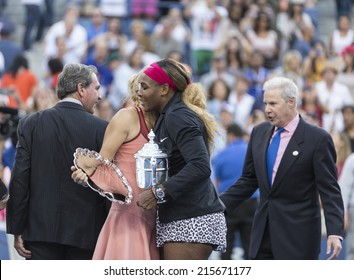 NEW YORK, NY - SEPTEMBER 7, 2014: Serena WIlliams of USA embraces Caroline Wozniacki of Denmark after winning final match against her at US Open championship in Flushing Meadows USTA Tennis Center