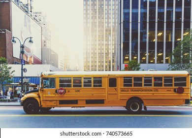 NEW YORK, NY - September 7th, 2017: Yellow school bus driving along a street in Manhattan