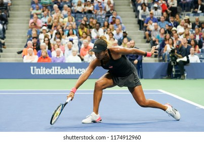 New York, NY - September 8, 2018: Naomi Osaka of Japan returns ball during women's single final of US Open 2018 against Serena Williams of USA at USTA Billie Jean King National Tennis Center