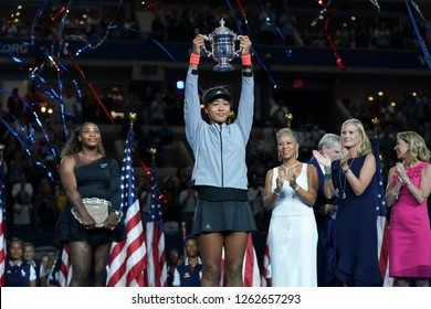 New York, NY - September 8, 2018: Naomi Osaka of Japan women's single final winner of US Open 2018 poses with trophy at USTA Billie Jean King National Tennis Center
