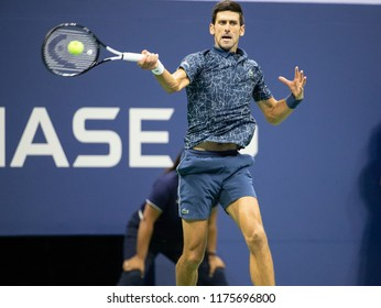 New York, NY - September 9, 2018: Novak Djokovic of Serbia returns ball during men's single final of US Open 2018 Juan Martin del Potro of Argentina at USTA Billie Jean King National Tennis Center