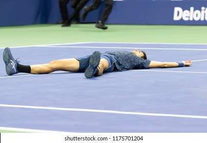 New York, NY - September 9, 2018: Novak Djokovic of Serbia collapses on court after victory in men's single final of US Open 2018 Juan Martin del Potro of Argentina at USTA National Tennis Center