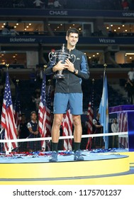 New York, NY - September 9, 2018: Novak Djokovic of Serbia holds trophy after winning men's single final of US Open 2018 against Juan Martin del Potro of Argentina at USTA National Tennis Center
